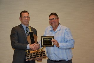 J.D. Johnston receiving the 2016 Educator of the Year award from outgoing President Doug Drever